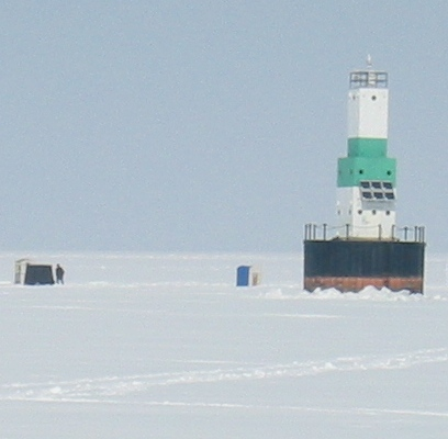 Escanaba Light and Ice Shanties - Copyright 2006 Marilyn K